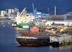 Del15a16 Fraser River Waterfront (CanadaGood) Tags: bridge blue red canada black color colour building green industry river boat ship bc crane forestry britishcolumbia delta tugboat barge fraserriver sawmill newwestminster 2015 canadagood thisdecade