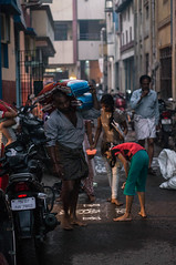 Carrying a Load (TAZMPictures) Tags: india night chennai pongal bhogi kolam rangoli triplicane