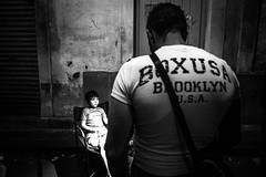 The big man and the little child (Andrea Scire') Tags: streetphotography