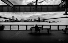 self-portrait between two bridges (gsusce) Tags: city nyc bridge blackandwhite bw ny newyork byn blancoynegro bench puente monocromo bridges banco ciudad bn brooklynbridge manhattanbridge puentes nuevayork nwn monocromtico puentedebrooklyn puentedemanhattan gsusce