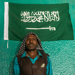 Sufi imam in front of islamic green flag, Harari region, Harar, Ethiopia (Eric Lafforgue) Tags: africa travel portrait people man color green square outdoors photography day adult african flag muslim islam faith religion indoor unescoworldheritagesite unesco indoors sword spirituality ethiopia sufi sufism worshipper oneperson hornofafrica ethiopian harrar eastafrica placeofworship harar abyssinia arabiccalligraphy traditionalclothing lookingatcamera harari oromo onemanonly waistup 1people harer harariregion hararjugol harergeprovince harergey ethio162913