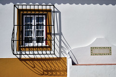 Sombras (Carla Robalo Martins) Tags: sombras shadows janela window grade grid alentejo portugal pontedesr banco bench amarelo yellow