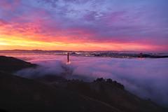 Meltdown (redblur) Tags: sanfrancisco california city bridge light orange color fog clouds sunrise landscape bay cityscape hills goldengatebridge baybridge bayarea lowfog