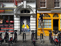 Queenie (The Popular Consciousness) Tags: uk greatbritain streetart london graffiti stencil mural unitedkingdom candid pedestrian bicycles painter vandalism tagging subversive thequeen edseasydiner