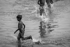 Childhood (arkamitralahiri) Tags: people blackandwhite india water monochrome kids river children nikon indian wave varanasi splash hindu hinduism kashi ghats banaras 70300 uttarpradesh beneras d3100