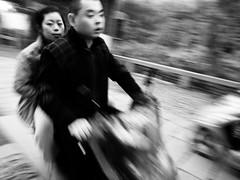 ride (-{ ThusOriginal }-) Tags: 2009 bw bike blackandwhite china couple digital grd3 grdiii monochrome people ricoh street suzhou thusihaveseen wind winter