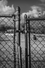 Full Circle (Thomas Pohlig) Tags: 675paces fence clouds landscape series journey blackandwhite monochrome fineart personal rust rusted rustedmetal gate