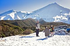 Fun in the snow (KiwiMiriam) Tags: mountain snow boy girl man sled boogieboard fuji xe2 mirrorless 23mm