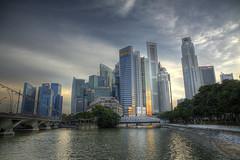 As the sun goes downtown (abhinavs_srinivas) Tags: city travel sunset skyline canon singapore downtown skyscrapers dusk soul cbd fullerton hdr singaporeriver marinabay eos50d