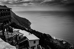 Mt Athos_Chalkidiki Greece (michael_kofteros) Tags: camera trees light sea sky blackandwhite bw cliff seascape mountains church monochrome clouds contrast digital landscape photography pier nikon shadows wildlife horizon shades monastery macedonia monks views rails peninsula chalkidiki whiteblack skete countrysite tinroofs panoramicviews cristianity agiooros d7000 michaelkofteros wooddenrails skycloudssunrisesunsets