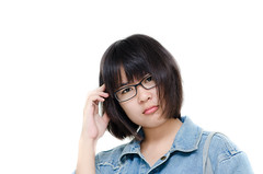 Young confused student and looking at camera. (Nuiiko) Tags: school portrait people woman white cute eye college girl smile female relax asian real happy person one glasses stand student education university alone looking adult head young documentary happiness file jeans study teen jacket thai backpack attractive confused teenager l casual positive eyeglasses scratched satchel educate learn isolated textbook confident teenage career profession eyewear occupation positivity