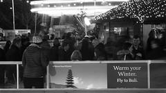 Festive Fair 010 (byronv2) Tags: christmas street blackandwhite bw monochrome night blackwhite edinburgh market candid iceskating skating fair christmasmarket icerink newtown nuit peoplewatching edimbourg saintandrewssquare edinburghbynight festivefair
