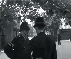 Metropolitan Police 'A' Division Sergeant And Constable Outside Clarence House, Stable Yard Road, St. James's, Westminster, London, SW1. UK. Both Officers would be attached To Cannon Row Police Station (Alpha Delta). Circa 1958. (sgterniebilko) Tags: uk london westminster ad security 1950s royalty themall sw1 royals royalfamily centrallondon scotlandyard stjamess metropolitanpolice clarencehouse alphadelta policeconstable inuniform canonrow stableyardroad cannonrowpolicestation aorwhitehalldivision
