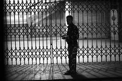 To LIGHT or not to LIGHT (N A Y E E M) Tags: street light portrait securityguard cigarette candid latenight bangladesh carwindow chittagong viptower