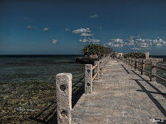 ... (Jean S..) Tags: blue sea sky white water clouds fence concrete grey dock cuba