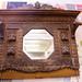 Ornate dark carved over mantle