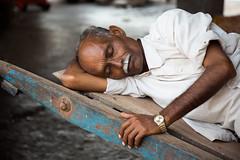 Sleeping man at the train station in Mumbai, India. (cookiesound) Tags: life street travel sleeping people india man face canon beard photography expression documentary trainstation bombay mumbai travelphotography travelphotographer cookiesound nisamaier ullimaier