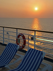Smooth Sailing, Caribbean Sea, 2005 (Tom Powell) Tags: caribbean carnivalfascination reflections canoneos20d 2005 yellow sunset orange