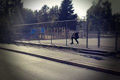 Playing Off the Ground (Wandering Eyes Photography) Tags: skateboard skater jump shadow trick ollie sports school city urban