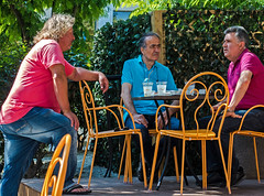 A Street Conversation (3) (Olympus OMD EM5II & mZuiko 12-40mm f2.8 Pro Zoom (1 of 1) (markdbaynham) Tags: street people island greek town zoom candid group hellas evil olympus greece pro gr f28 omd csc mz limnos hellenic m43 zd mft lemnos myrina em5 1240mm mirrorless micro43 micro43rd mzuiko em5ii zuikolic