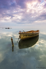 Delta Dreams XIV. (dasanes77) Tags: ocean longexposure sea seascape water sunrise reflections landscape dawn boat shadows horizon tripod delta ropes cloudscape tarragona abandonedboat santcarlesdelarpita underwaterplants canonef1635mmf4lisusm nohorizonline cloudsmovement canoneos6d topcanon