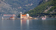 Manmade island - Montenegro (stevelamb007) Tags: lighthouse reflection church island christian orthodox montenegro tourboat kotor d90 kotorbay stevelamb