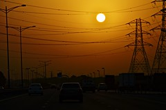 END OF THE DAY (Ashraful Tareq) Tags: sun car highway dubai uae ash fujaira tareq ashraful