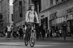Light cycle (Capt'n Red Beard) Tags: street blackandwhite bw woman monochrome bicycle female liverpool mono ride candid sony cycle