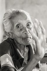 Kelembutan (Sarah Csillagi) Tags: old portrait bali woman monochrome face indonesia blackwhite nikon femme oldness nb ibu indonsie buleleng kelembutan