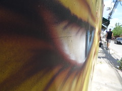 Eye on you - Prapokklao Road - Chiang Mai, Thailand (ashabot) Tags: streetart yellow thailand graffiti eyes odd chiangmai streetscenes