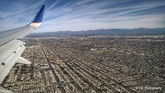 Bird-eye view at LA (elnina999) Tags: above ca travel blue sky terrain cloud holiday mountains building green window nature field weather plane airplane landscape fly nokia losangeles high airport day ray looking view desert bright earth aircraft aviation flight wing lakes houston atmosphere sunny aerial hills airline rivers land layer phonecamera airliner stratosphere
