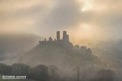 Misty Corfe Castle (Chris Jones www.chrisjonesphotographer.uk) Tags: chris england mist west castle misty fog sunrise photography coast jones photo south hill dorset corfe swanage jurassic purbecks wwwbluewaterphotographycouk