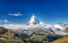 It's sunny at the top (Maarten Mensink) Tags: cliff mountain alps beautiful clouds switzerland intense shadows swiss famous peak massive alp hdr highdynamicrange impressive subtlehdr