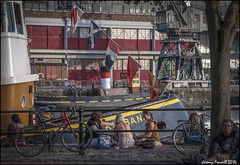 Summer in the City ( Explored 21/ 01/15 ) (zolaczakl) Tags: bristol harbourside photographybyjeremyfennell 2014 narrowquay mshed crane boats people flags july nikond90 johnking tree bicycles railing exploredinflickr explored