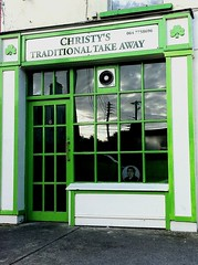 Reflections in Christy's window (JulieK (thanks for 7 million views)) Tags: street ireland irish reflection window shop restaurant kerry chips takeaway telegraphpole shamrock chipshop rathmore hww iphone4 uploaded:by=flickrmobile ilobsterit colorvibefilter flickriosapp:filter=colorvibe 115picturesin2015