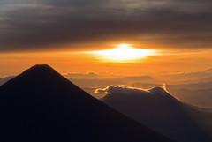 Sun rises over Agua and Pacaya volcanos, Guatemala (Miche & Jon Rousell) Tags: red orange yellow sunrise volcano lava agua purple guatemala hike ash fuego eruption volcan acatenango strombolian