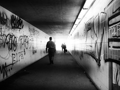 exit (Sandy...J) Tags: street city light people urban bw sunlight white man black silhouette wall germany underpass walking bayern deutschland photography mono licht blackwhite women fotografie grafitti walk wand streetphotography atmosphere tunnel olympus menschen stadt sw mann monochrom frau passage atmosphre augsburg mauer bavarian gehen unterfhrung schwarzweis strasenfotografie