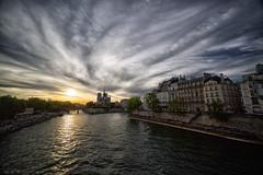 Sunset in Paris (marko.erman) Tags: city bridge light sunset sky panorama cloud sun paris france water seine buildings reflections cityscape sony notredame romantic cloudscape iledelacit uwa