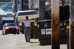 Mattress Haul (Vegan Butterfly) Tags: street city people urban walking outside person alley edmonton walk candid mattress carry carrying