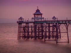 Clevedon Pier u.k (Wizard CG) Tags: ocean blue sunset sea england sky orange seascape english heritage beach water skyline architecture river bristol landscape gold 1 coast amber pier seaside sand colorful waterfront outdoor piers united ngc kingdom arches grade severn shore historical channel listed clevedon cloudsstormssunsetssunrises epl7