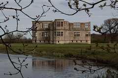 Lyveden New Bield framed by a tree (Carol Spurway) Tags: new nt northamptonshire elizabethan nationaltrust newbuild lyveden bield oundle