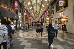 Shopping Arcade in Kyoto (Igor Voller) Tags: roof people glass japan shop architecture umbrella shopping lights kyoto leute flag arcade tourists walkway  shops  geschft   regenschirm