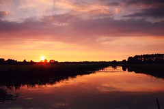Tonight's sunset (M a u r i c e) Tags: sunset sky sunlight water netherlands pond dusk wideangle efs1022mm ultrawidezoom