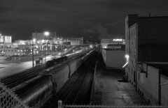 Alley by the Port (Orion Alexis) Tags: street old blackandwhite industry film monochrome night vancouver port 35mm downtown industrial trains east fujifilm neopan 100 hastings van across eastside tx1