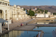 Pushkar, India (DitchTheMap) Tags: old city travel sky people india lake building monument water architecture temple person town site pond asia flickr cityscape desert bright background indian traditional hill culture landmark reservoir hills holy historical pushkar hindu pilgrimage thar rajasthan brahma ghat 2016 aravalli lakepushkar