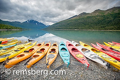 Kayaks lined up in front of Lake Eklutna near Anchorage Alaska (Remsberg Photos) Tags: life usa mountain lake cold nature water beauty sport alaska landscape outdoors freedom fantastic colorful kayak peace open natural vibrant floating wideangle nopeople adrift adventure kayaking serenity need imagination remote leisure balance concept anticipation overlooking excitement exploration frigid majestic idyllic addiction luxury partnership multitude kayaks digitalimage linedup forwards admiration onourway downtheroad aligned movingforward lakeeklutna coldtemperature headingoff