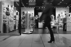 Invisible step (Matej Reviliak) Tags: people motion blur shop blackwhite movement step