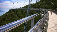 Walking through the top of virgin rainforest (leewoods106) Tags: trip travel bridge blue trees vacation people cloud mountain holiday mountains reflection tree green beautiful metal architecture clouds reflections walking children spectacular photography photo rainforest asia southeastasia child view suspension photos walk steel skybridge cable rope pylon palmtrees walkway jungle views malaysia cablecar mountainside traveling langkawi suspensionbridge tranquil traveler beautifulplaces spectacularview virginjungle machinchang langkawiskybridge virginrainforest mustseeplaces giantspectacular 10millionyearoldrainforest machinchangmountain