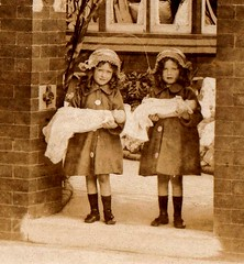 Detail of the two young girls and their dolls (EastMarple1) Tags: house girl socks twins shoes doll buttons postcard coat straw gateway bonnet edwardian ringlets
