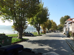 kastoria lake hellas (omirou56) Tags: street trees sky lake green cars nature water shadows hellas greece macedonia timeless            sonydschx9v